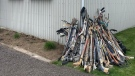 Hundreds of collected hockey sticks are seen outside Snipe Hockey Academy. (Facebook)