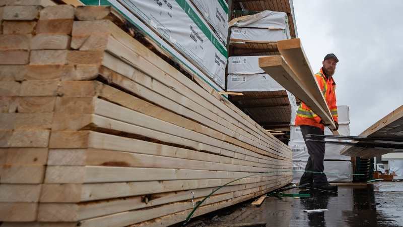 FILE - Doug Howson loads lumber onto a forklift at Haney Builders Supplies, in Maple Ridge, B.C., on Friday, June 12, 2020. THE CANADIAN PRESS/Darryl Dyck