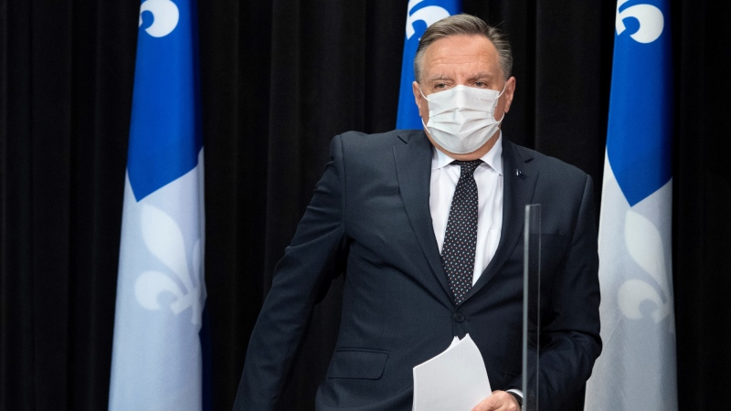 Quebec Premier Francois Legault walks in a news conference on the COVID-19 pandemic, Tuesday, April 27, 2021 at the legislature in Quebec City. THE CANADIAN PRESS/Jacques Boissinot