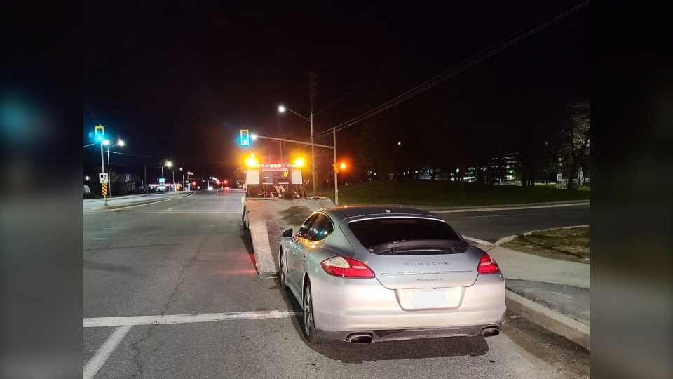 Porsche Panamera 4 being loaded onto tow truck