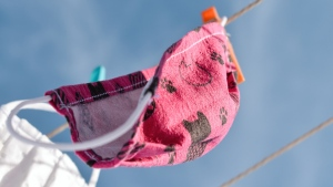 Cloth face masks hang to dry on a clothesline. (Photo by Jacek Pobłocki on Unsplash)