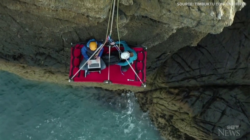 Digital nomad Jason Griffin claims he can work from anywhere with a mobile connection and his laptop, even dangling from a cliff.