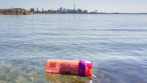 Orange water bottles are floating around Lake Ontario as part of a University of Toronto research program. (Twitter / @UofTTrashTeam)