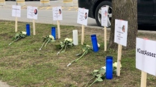 A vigil was held in Mercier Wednesday for the victims of domestic violence (photo: Stephane Giroux / CTV News Montreal)