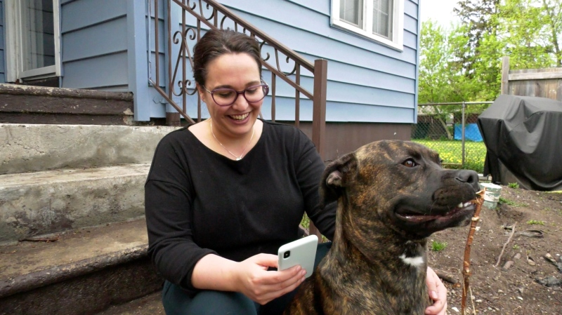 Nancy Lefebvre uses the 'Nextdoor' app as she sits on her back porch in East Windsor on April 28, 2021. (Rich Garton/CTV Windsor)
