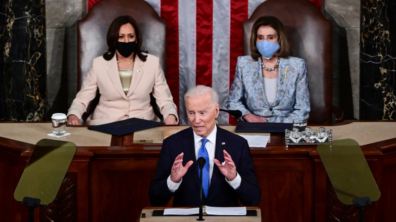 U.S. President Joe Biden addresses a joint session of Congress, Wednesday, April 28, 2021, in the House Chamber at the U.S. Capitol in Washington, as Vice President Kamala Harris, left, and House Speaker Nancy Pelosi of Calif., look on. (Jim Watson/Pool via AP)