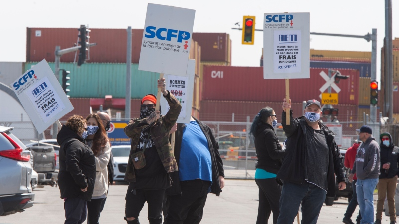 Port of Montreal workers picket on the second day of their strike Tuesday, April 27, 2021 in Montreal. The workers have been without a contract for over two years. (THE CANADIAN PRESS/Ryan Remiorz)