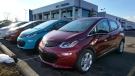A 2021 Chevrolet Bolt EV, is displayed with 2020 models at Bill Crispin Chevrolet in Saline, Mich., on Feb. 25, 2021. (Carlos Osorio / AP)