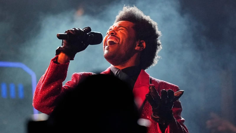 The Weeknd performs during the halftime show of the NFL Super Bowl 55 football game on Feb. 7, 2021, in Tampa, Fla. The Weeknd was snubbed by the Grammys but he's the leading nominee at the 2021 Billboard Music Awards. (AP Photo/David J. Phillip, File)