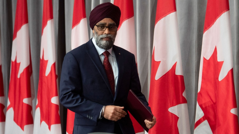 National Defence Minister Harjit Sajjan takes his seat for a news conference Friday, June 26, 2020 in Ottawa. THE CANADIAN PRESS/Adrian Wyld