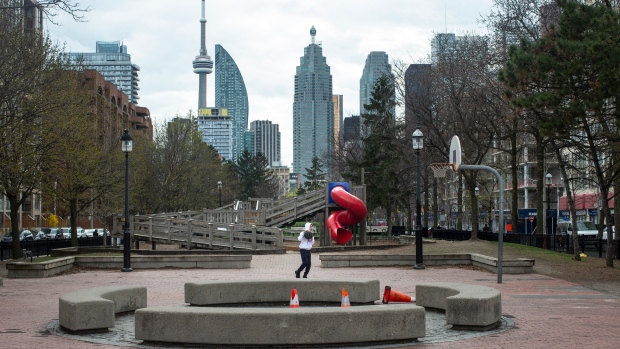 A youth plays basketball in an otherwise quiet court in Toronto. Public health experts are raising their eyebrows at Ontario's decision to restrict outdoor gatherings, saying the latest evidence suggests the measures won't do much to cut down on COVID-19 transmission. THE CANADIAN PRESS/Chris Young