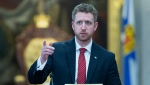 Nova Scotia Premier Iain Rankin takes questions from reporters after the speech from the throne at the legislature in Halifax on Tuesday, March 9, 2021. The CANADIAN PRESS/Andrew Vaughan