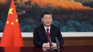 In this photo released by Xinhua News Agency, Chinese President Xi Jinping delivers a keynote speech via video for the opening ceremony of the Boao Forum for Asia (BFA) Annual Conference, in Beijing Tuesday, April 20, 2021. (Ju Peng/Xinhua via AP)