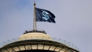 A flag with the new logo for the Seattle Kraken flies atop the iconic Space Needle Thursday, July 23, 2020, in Seattle. (AP / Elaine Thompson)