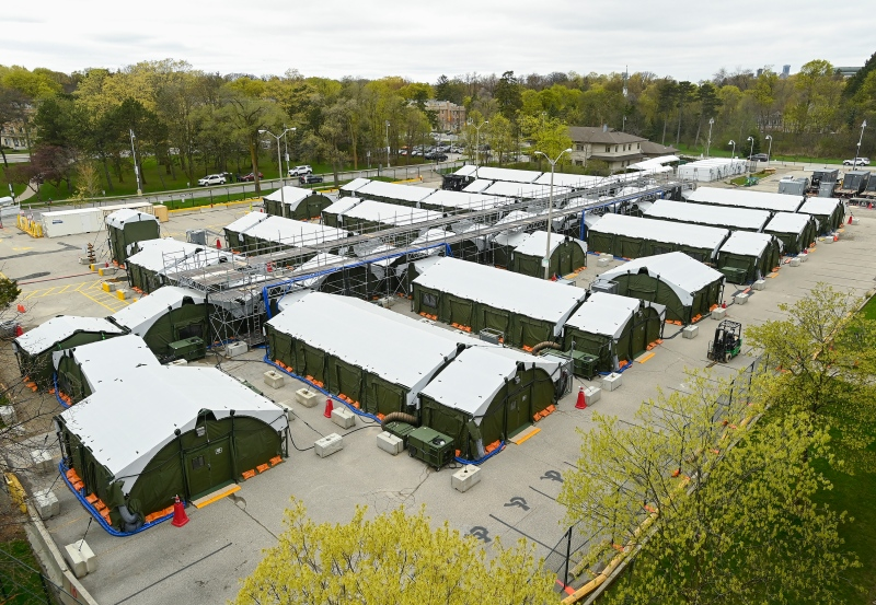 A mobile health unit is shown on the grounds of Sunnybrook Hospital during the COVID-19 pandemic in Toronto on Friday, April 30, 2021. THE CANADIAN PRESS/Nathan Denette