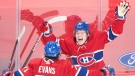 Montreal Canadiens' Cole Caufield (22) celebrates with teammate Jake Evans after scoring against the Ottawa Senators during overtime NHL hockey action in Montreal, Saturday, May 1, 2021.THE CANADIAN PRESS/Graham Hughes