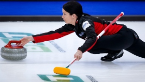 Canada skip Kerri Einarson releases a stone against Switzerland at the Women's World Curling Championship in Calgary, Alta., Saturday, May 1, 2021. (THE CANADIAN PRESS/Jeff McIntosh)