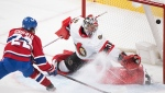 Montreal Canadiens' Cole Caufield scores against Ottawa Senators' goaltender Filip Gustavsson during overtime NHL hockey action in Montreal, Saturday, May 1, 2021.THE CANADIAN PRESS/Graham Hughes
