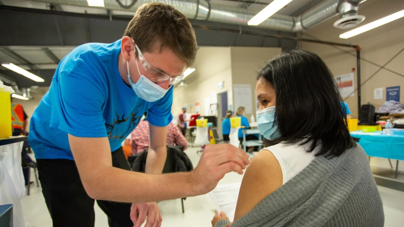 An employee of the Cargill beef-packing plant receives a COVID-19 vaccination in High River, Alberta on Thursday April 29, 2021. THE CANADIAN PRESS/HO-Jason Dziver