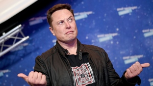 SpaceX owner and Tesla CEO Elon Musk arrives on the red carpet for the Axel Springer media award, in Berlin, Germany, Tuesday, Dec. 1, 2020. (Britta Pedersen/Pool via AP)