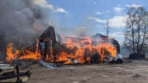 A barn on Mitch Owens Road in Greely was fully engulfed in flames when Ottawa firefighters arrived May 2, 2021. (Photo by Scott Stilborn / @OFSFirePhoto / Twitter)