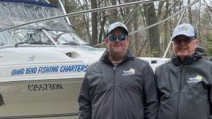 Ryan and Rob Sharpe stand in front of their boat (Source: Ryan Sharpe)