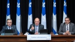 Quebec Health Minister Christian Dube, centre, speaks during a news conference on the COVID-19 pandemic, Thursday, April 29, 2021 at the legislature in Quebec City. Horacio Arruda, Quebec director of National Public Health, left, and Daniel Pare, head of the vaccination campaign in Quebec, right, look on. The government announced the opening of vaccination for all adults by May 14. THE CANADIAN PRESS/Jacques Boissinot