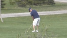 A man is seen golfing at the currently closed Fanshawe Golf Course on Sunday, May 2, 2021. (Sean Irvine / CTV London)