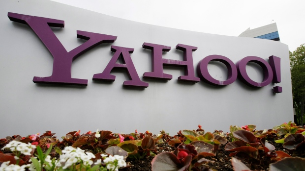 The Yahoo logo is displayed outside of offices in Santa Clara, Calif., in this Monday, April 18, 2011, file photo. Verizon is selling the segment of its business that includes Yahoo and AOL to private equity firm Apollo Global Management in a $5 billion deal. Verizon said Monday, May 3, 2021, that it will keep a 10 per cent stake in the new company, which will be called Yahoo. (AP Photo/Paul Sakuma, File)