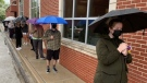 People lined up for a pop-up COVID-19 vaccination clinic for those 18 and older opened at St. Angela Centre and Hall on Erie Street in Windsor, Ont. on Monday, May 3, 2021. (Chris Campbell/CTV Windsor)