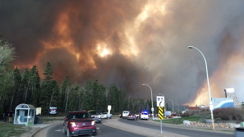 Dark smoke rises over the Beacon Hill area of Fort McMurray on Tuesday, May 3, 2016.