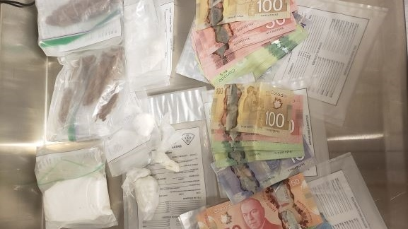 On April 30, 2021, members of the OPP and uniformed officers executed two search warrants, one on a residence on West Street and the other on an apartment on Mississaga Street in Orillia, Ont. (Supplied)