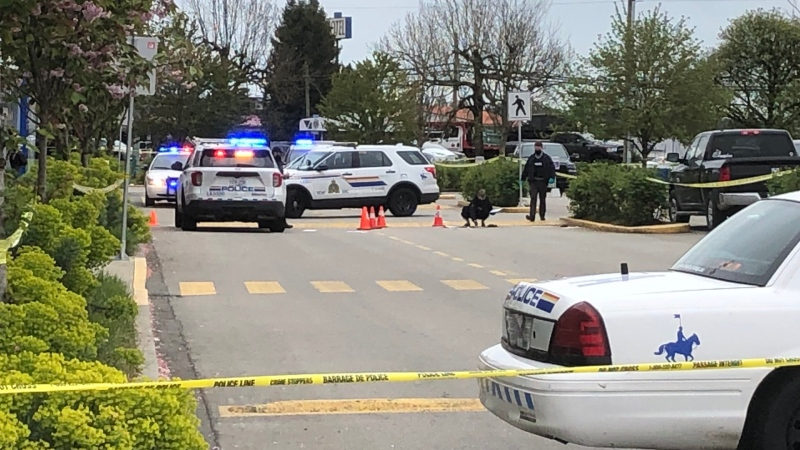 Police respond to a shooting at Willowbrook Mall in Langley, B.C., that left a man with potentially life-threatening injuries on May 3, 2021.