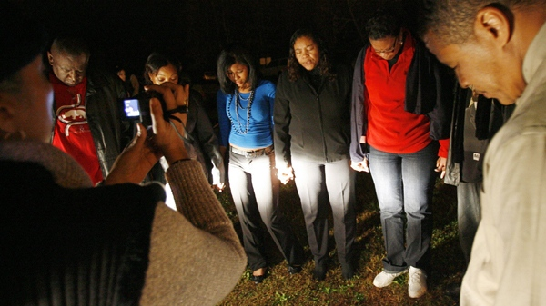 Family members of John Allen Muhammad pray outside Greenville Correctional Center in Jarratt, Va., at the scheduled time of his execution on Tuesday, Nov. 10, 2009. (AP / Dean Hoffmeyer)