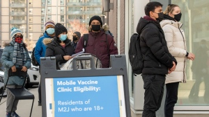 Visitors line up at a mobile COVID-19 vaccine clinic at Parkway Forest Community Centre in Toronto on Monday, April 19, 2021.THE CANADIAN PRESS/Frank Gunn
