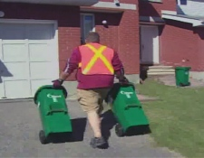 Green bins are delivered to Ottawa homes in advance of the city's new composting program.