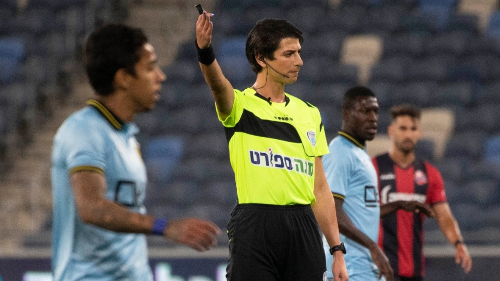 Sapir Berman works an Israeli Premier League game