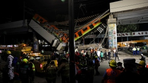 Mexico City's subway cars lay at an angle after a section of Line 12 of the subway collapsed in Mexico City, on May 4, 2021. (Marco Ugarte / AP)