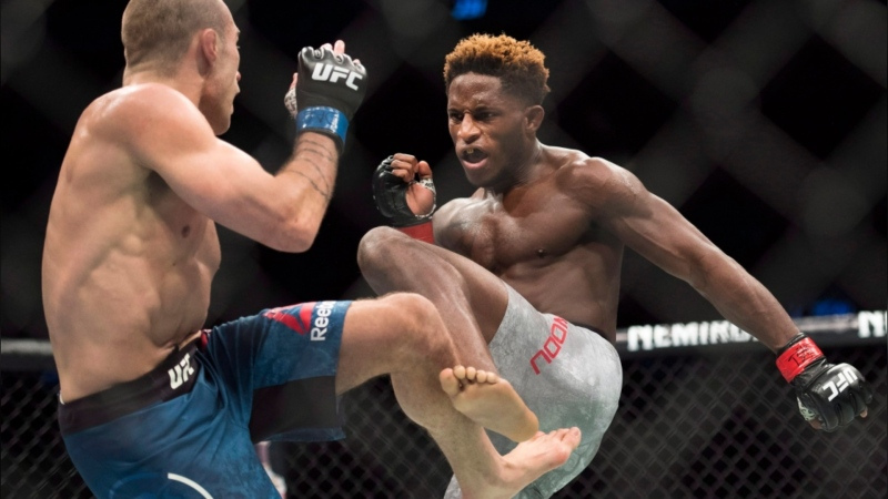 Hakeem Dawodu, right, fights Kyle Bochniak during a UFC featherweight bout in Toronto on Saturday, Dec. 8, 2018. (THE CANADIAN PRESS / Nathan Denette)