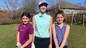 Rachel Henderson, left, Sarah Henderson and Julia Henderson are among the Saskatchewan girls taking up golf. (Carla Shynkaruk/CTV Saskatoon)