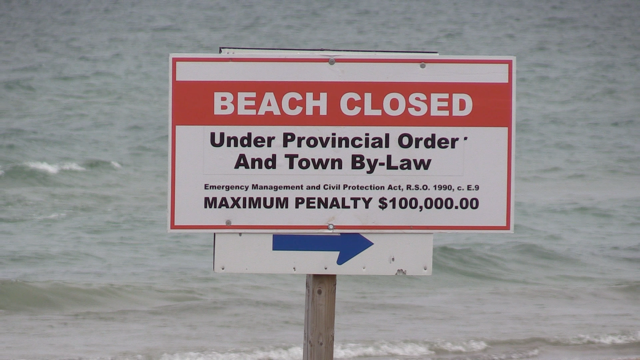Beach closed sign on Lake Huron (Scott Miller/CTV London)