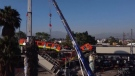 Drone footage shows crews working to stabilize a collapsed bridge in Mexico City while train carriages continue to hang from the overpass.