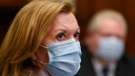 Ontario Health Minister Christine Elliott listens as Ontario Premier Doug Ford gives an update regarding the Ontario COVID-19 vaccine during the COVID-19 pandemic in Toronto on Tuesday, January 5, 2021. THE CANADIAN PRESS/Nathan Denette