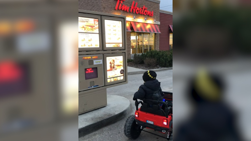Three-year-old Chase Burton from Oakbank, Man., drives his battery powered Jeep through the local Tim Hortons drive-thru. (Source: Kristy Middleton)
