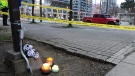 Candles are pictured at the scene where a five-year-old boy was fatally struck by a vehicle in Mississauga Tuesday, May 4, 2021. (Mike Walker / CTV News Toronto)