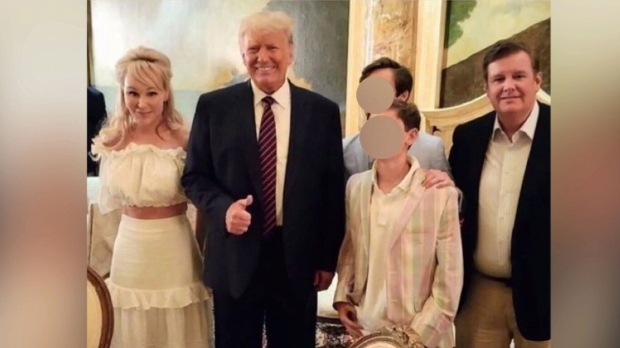 This photo was taken and posted to Suzanne Rogers' Instagram, showing her and her husband posing with former U.S. president Donald Trump.
