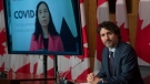 Chief Public Health Officer Theresa Tam appears via video conference as Prime Minister Justin Trudeau attends a news conference in Ottawa on Tuesday May 4, 2021. THE CANADIAN PRESS/Adrian Wyld