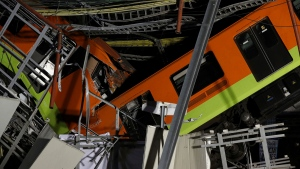 Mexico City's subway cars lay at an angle after a section of Line 12 of the subway collapsed in Mexico City, Tuesday, May 4, 2021. (AP / Marco Ugarte)