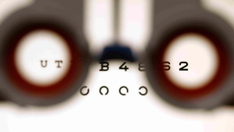 An optometrist holds glasses in front a lightbox during an eyesight test in Bremen, Germany, on Friday, Jan. 16, 2009. (THE CANADIAN PRESS/AP/Joerg Sarbach)