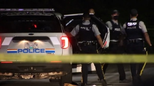 RCMP officers respond to a shooting in Surrey, B.C., that left a woman fatally injured on May 4, 2021.